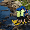 Volunteers unleash the ducks to kickoff the duck race at Riverfront Park in Fitchburg on Sunday afternoon. SENTINEL & ENTERPRISE / Ashley Green