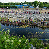 Spectators gather to watch the duck races at Riverfront Park in Fitchburg on Sunday afternoon. SENTINEL & ENTERPRISE / Ashley Green
