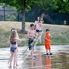 Kids cool off in the splash park at Riverfront Park in Fitchburg on Sunday afternoon. SENTINEL & ENTERPRISE / Ashley Green