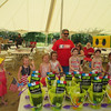 Every kid who participated in the Doll Carriage and Bike Parade received a sand pail filled with goodies. SENTINEL & ENTERPRISE / Julia Sarcinelli