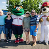 Ron and Donna Tourigny, along with Joanne and Stephen DiNatale greet Wally the Green Monster and Digger the Dirt Dawg at Riverfront Park in Fitchburg on Sunday afternoon. SENTINEL & ENTERPRISE / Ashley Green
