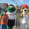 Anthony Wheeler, 15, and Ryan Wheeler, 11, from Fitchburg smile with Wally the Green Monster and Digger from the Wachusett Dirt Dawgs. SENTINEL & ENTERPRISE / Julia Sarcinelli