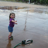 Elise Sabolevski, 2, from Fitchburg cools off in the sprinkler at Riverfront Park. SENTINEL & ENTERPRISE / Julia Sarcinelli