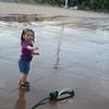 Elise Sabolevski, 2, from Fitchburg cools off in the sprinkler at Riverfront Park. SENTINEL & ENTERPRISE / Julia Sarcinelli