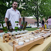 Nick Squailia sells his engraved wood products from Rustic Craft at the Fitchburg Farmers Market. The market, usually held at Riverfront Park, will now be held on the Upper Common every Thursday 4-7 pm through the fall. SENTINEL & ENTERPRISE / Ashley Green