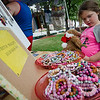 Scarlett Brooks, 6, checks out an assortment of handmade jewelry at the Fitchburg Farmers Market. The market, usually held at Riverfront Park, will now be held on the Upper Common every Thursday 4-7 pm through the fall. SENTINEL & ENTERPRISE / Ashley Green