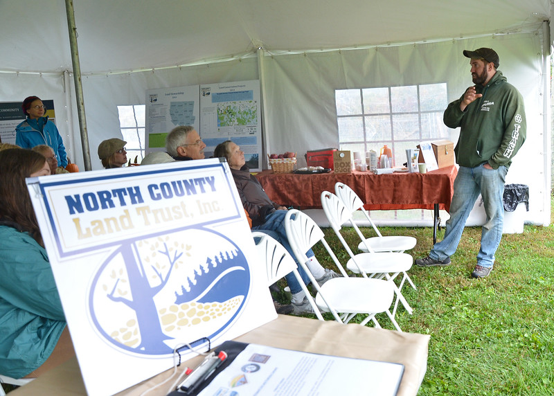 Jim Lattanzi, owner of Hollis Hills Farms, speaks to a group at the Fitchburg Harvest Fair at Hollis Hills Farm on Saturday afternoon. SENTINEL & ENTERPRISE / Ashley Green
