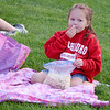"Alaina Salafia, 8, of Fitchburg, snacks on some popcorn during the showing of ""Frozen"" at Nikitas Field in Fitchburg on Friday night. SENTINEL & ENTERPRISE / Ashley Green"