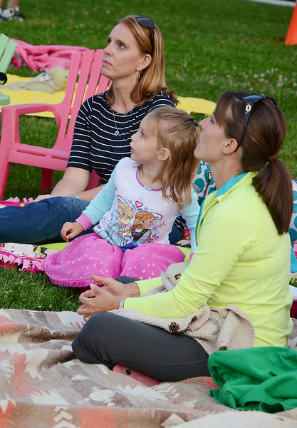 "Jen Ledoux, Avery Ledoux, 3, and Jessica Elliott enjoying the showing of ""Frozen"" at Nikitas Field in Fitchburg on Friday night. SENTINEL & ENTERPRISE / Ashley Green"
