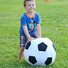 "Avery Camerano, 3, of Fitchburg, plays with a soccer ball before the showing of ""Frozen"" at Nikitas Field in Fitchburg on Friday night. SENTINEL & ENTERPRISE / Ashley Green"