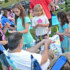 "Mackenzie Belleza, 8, Jordyn Butler, 10, Brooke Lyons, 6, Ruby Dupuis, 3, and Peyton Lyons, 5, enjoy some glow-in-the-dark bracelets from Greg Belleza during the showing of ""Frozen"" at Nikitas Field in Fitchburg on Friday night. SENTINEL & ENTERPRISE / Ashley Green"