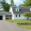 John Angelini has leased solar panels with Great Sky Solar to save 70 percent of his electricity, heating, cooling and pool costs, shown here at his home on Shea Street on Friday afternoon. SENTINEL & ENTERPRISE / Ashley Green