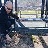 Christopher Benoit picks up debris during the Gateway Park Community Gardens open house session on Saturday morning in Fitchburg. SENTINEL & ENTERPRISE / Ashley Green