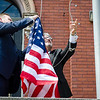 Mayor Stephen DiNatale and Chief of Staff AJ Tourigny hang the American, Florida state and LGBTQ pride flag over Old City Hall in downtown Fitchburg on Thursday morning. SENTINEL & ENTERPRISE / Ashley Green