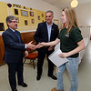 Fitchburg Mayor Stephen DiNatale and Leominster Mayor Dean Mazzarella thank Leominster CTEi student Shelby Bosworth during a ceremony to thank CTEi for their rennovation contributions to the New Patriots Veterans Outreach Center on Friday morning. SENTINEL & ENTEPRISE / Ashley Green