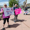 Aimee Marceau and Anita Sullivan hold signs during the pro-life and pro-choice rally outside Planned Parenthood in Fitchburg on Saturday morning. SENTINEL & ENTERPRISE / Ashley Green