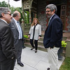 Mayor Stephen DiNatale and Fitchburg State President Richard Lapidus greet each other at the President's home before a luncheon with representatives from Fitchburg's sister city, Kleve, Germany on Thursday afternoon. SENTINEL & ENTERPRISE / Ashley Green