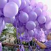 Gus Vergara hangs balloons at a vigil in Cleghorn for Roy Rivera on Tuesday night in Fitchburg. SENTINEL & ENTERPRISE/ JOHN LOVE
