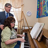 Mayor Stephen DiNatale joins Lorna Chabot to sing some tunes during a group birthday party at Valley Stream Rehabilitation and Healthcare Center on April 15. SENTINEL & ENTERPRISE / Ashley Green
