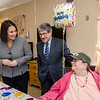 State Senator Jennifer Flanagan and Mayor Stephen DiNatale greet Johann Alexander during a group birthday party at Valley Stream Rehabilitation and Healthcare Center on April 15. SENTINEL & ENTERPRISE / Ashley Green
