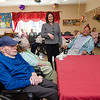 State Senator Jennifer Flanagan greets patients during a group birthday party at Valley Stream Rehabilitation and Healthcare Center on April 15. SENTINEL & ENTERPRISE / Ashley Green