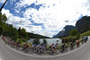 The peloton circles a pretty lake somewhere in Trentino...