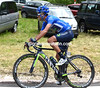 Benat Intxausti is chasing this move - he'll join them over the top of the climb..