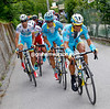 Tiralongo and Landa carry Aru on to the Mortirolo...