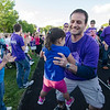 Harper Johnson, 3, runs into dad Marc's arms during the survivor's lap at the Greater Gardner Relay for Life on Friday evening. SENTINEL & ENTERPRISE / Ashley Green