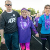 Kevin and Lora Grimley support Linda Kerouac during the survivors lap at the Greater Gardner Relay for Life on Friday evening. SENTINEL & ENTERPRISE / Ashley Green