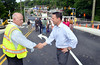 Montgomery County Commisioners chairman Josh Shapiro, right, shakes hands with PennDot resident engineer Steve Ryan following the opening of the Greenwood Avenue  bridge spanning the SEPTA tracks between Jenkintown and Cheltenham Township.   Monday, June 30, 2014.   Photo by Geoff Patton