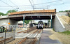 A train passes beneath the  Greenwood Avenue bridge spanning the SEPTA tracks between Jenkintown and Cheltenham Township.   Monday, June 30, 2014.   Photo by Geoff Patton