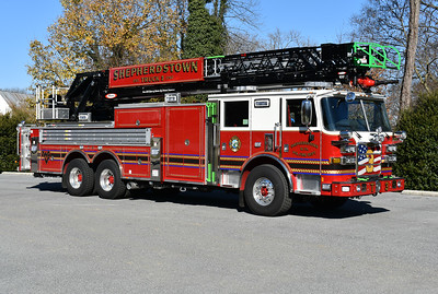Truck 3 from Shepherdstown, West Virginia is this 2017 Pierce Arrow XT with a 105' rear mount aerial, painted in black.  At night, the ladder rungs are lit up red, white, and blue.  Truck 3 was photographed in November of 2017 shortly after being delivered and being prepared for service.