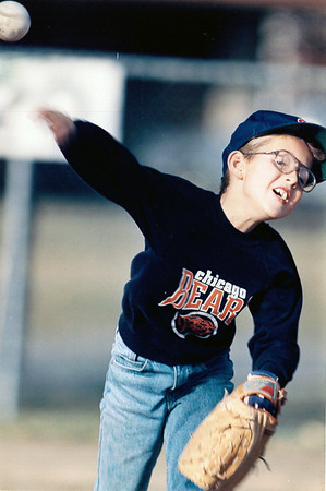 A young ballplayer in a Chicago Bear shirt throws a ball with all his might. Do you recognize the player? If so, post under the photo.