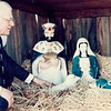 A nativity scene gets looked over by a gentleman. Do you know him, or when the photo would have been taken? If so, share the information at the Effingham Daily News Facebook page.