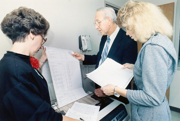 Effingham County Clerk Bob Behrman had a little help looking over paperwork at the County Clerk's office some years ago. Do you recognize his helpers? If so, post under the photo online at the Effingham Daily News Facebook page.