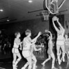 St. Anthony and Newton players are shown under the basket during a game. Do recognize the players or know when the photo would have been taken? If so, share the information under the photo on the Effingham Daily News Facebook page.