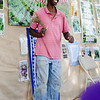 Sangiwa Eliamani speaks about his experience as a farmer during Flats Mentor Farm's 2nd Annual Tour de Farm on Friday afternoon. SENTINEL & ENTERPRISE / Ashley Green