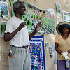 Andrew Kimwomi and Josephine Kihu speak about their experience as farmers during Flats Mentor Farm's 2nd Annual Tour de Farm on Friday afternoon. SENTINEL & ENTERPRISE / Ashley Green