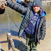 Micah Gilmore, 10, shows off his catch during the Barrett Park fishing derby on Saturday morning in Leominster. SENTINEL & ENTERPRISE / Ashley Green