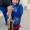Camden Larkin, 5, shows off his catch during the Barrett Park fishing derby on Saturday morning in Leominster. SENTINEL & ENTERPRISE / Ashley Green