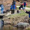 Mireille Permatteo, 9, casts her line during the Barrett Park fishing derby on Saturday morning in Leominster. SENTINEL & ENTERPRISE / Ashley Green