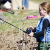 Mireille Permatteo, 9, focuses on her line during the Barrett Park fishing derby on Saturday morning in Leominster. SENTINEL & ENTERPRISE / Ashley Green