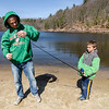Michael Martin lends a hand to Michael, 8, during the Barrett Park fishing derby on Saturday morning in Leominster. SENTINEL & ENTERPRISE / Ashley Green