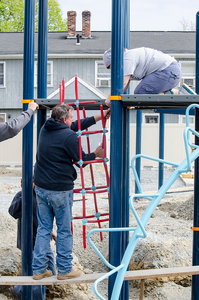 Volunteers gathered on Third Street in Leominster on Saturday morning to help construct the Louis Charpentier Playground. SENTINEL & ENTERPRISE / Ashley Green