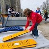 Sharon Testa organizes pieces while volunteers help construct the Louis Charpentier Playground on Third Street in Leominster on Saturday morning. SENTINEL & ENTERPRISE / Ashley Green