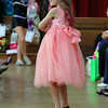 Brianna Gray, 8, models clothes from Cutie Patuties in Leominster during the fashion show at the Ladies Night Out at the City Hall on Thursdays night. SENTINEL & ENTERPRISE/JOHN LOVE