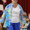 Peggy Christoforo models clothes from Allens in Leominster during the fashion show at the Ladies Night Out at the City Hall on Thursdays night. SENTINEL & ENTERPRISE/JOHN LOVE