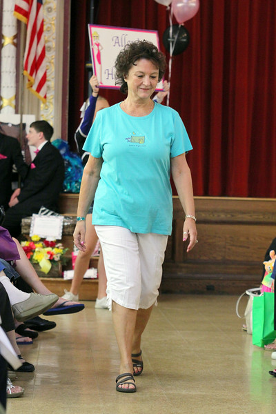 Angela Wallace models clothes from Allens in Leominster during the fashion show at the Ladies Night Out at the City Hall on Thursdays night. SENTINEL & ENTERPRISE/JOHN LOVE