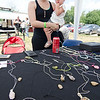 Tabitha Cardona, Frankie's sister, along with her daughter Ariana, 2, sell jewelry to raise money during the Good Times Motorcycle Run in memory of hit-and-run victim Frankie Fortuna on Saturday morning. SENTINEL & ENTERPRISE / Ashley Green